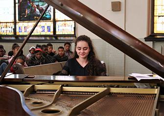 Fellow Aleksandra Kasman performing for students at Hephatha Lutheran Church.